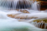 soft water of the stream on the rocks