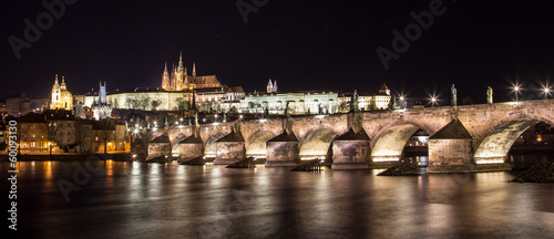 Poster Prague Panorama of Prague Castle and Charles Bridge at night
