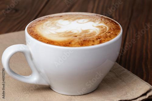 freshly made cup of cappuccino with abstract latte art Tapéta, Fotótapéta