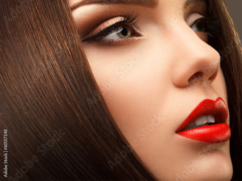 Fotografie, Obraz Woman Eye with Beautiful Makeup. Red Lips. High quality image.