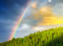 Rainbow After Rain In The Mountain Valley.
