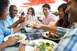 canvas print picture - Group Of Friends Enjoying Meal At Outdoor Restaurant