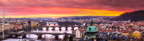 Spoed Foto op Canvas Lavendel Bridges in Prague over the river at sunset