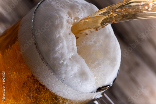 Glass of beer, close-up Wallpaper Mural