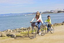 Mother And Daughter Biking Alo...