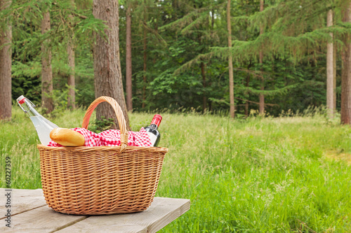Poster Picnic Picnic basket in a woodland setting