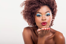 Young African Woman Blowing A Kiss