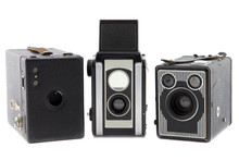 Three Retro Photo Cameras On A Row