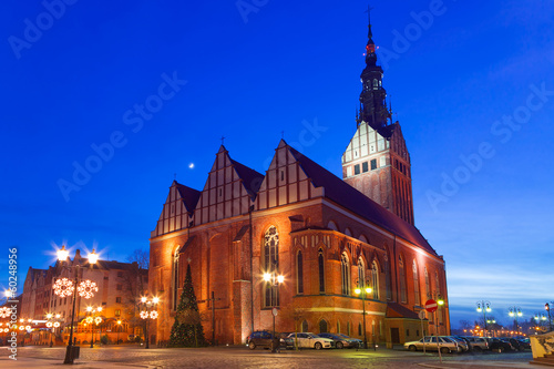 Foto auf Leinwand Dunkelblau St. Nicholas Cathedral in old town of Elblag, Poland