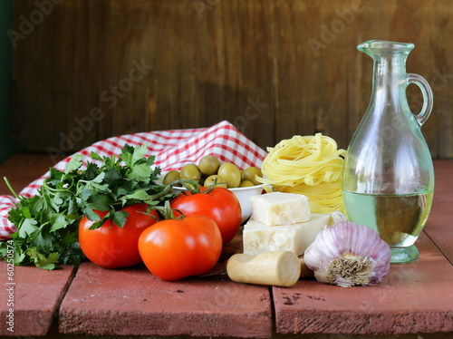 Poster Dairy products Italian food still life - pasta, olive oil, tomatoes, garlic