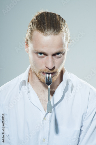 Photo  humorous man with fork