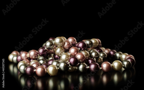 colored pearls on a black background