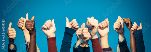 Multiracial Thumbs Up Against Blue Sky Wallpaper Mural