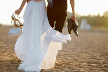 Bride And Groom On A Beach At ...