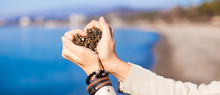 Woman Hands Holding Small Stones Form Heart Shape Background The