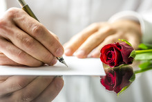 Romantic Man Writing A Love Le...