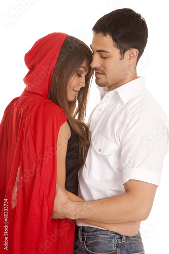 man and red riding hood arms around each other Plakát