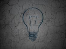 Finance Concept: Light Bulb On Grunge Wall Background