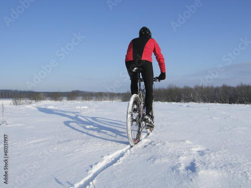 Poster Cycling Mountain bike riding through snow
