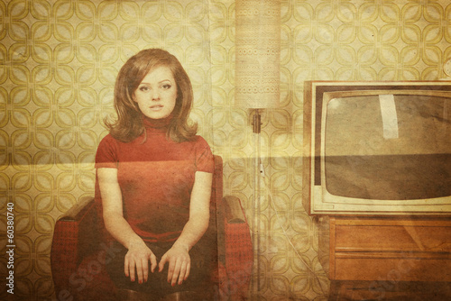 Photographie  art portrait of young woman looking out at camera in room with v