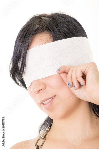 Fotografie, Obraz  Portrait of a hispanic woman with white blindfold