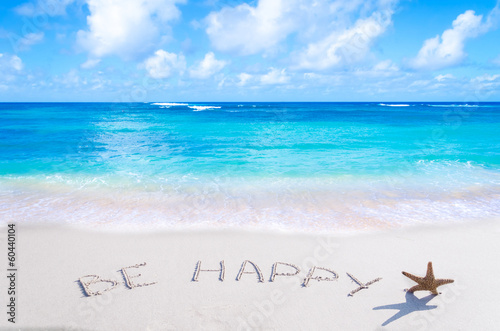 "Photo  Sign""Be Happy"" with starfish on the beach"