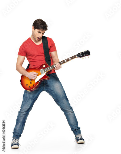 Guitarist man plays on the electric guitar Tablou Canvas
