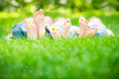 Leinwandbild Motiv Family lying on grass