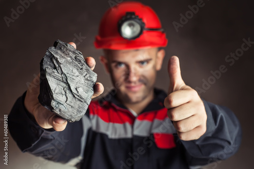 Photographie Coal miner with lump of coal