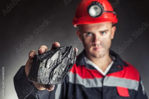 Fotografia Coal miner showing lump of coal