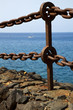 rusty chain water yacht coastline and summer in lanzarote