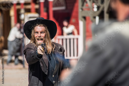 Fototapeta Cowboy Points Gun