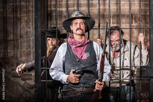 Fotografie, Obraz  Tough Sheriff  With Prisoner