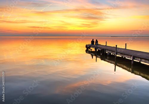 Foto auf AluDibond Pier mirando el amanecer