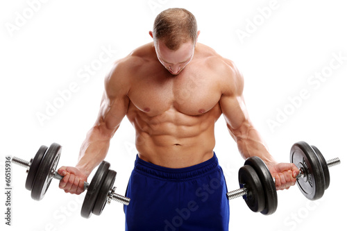 Photo  Bodybuilding. Strong man with a dumbbell