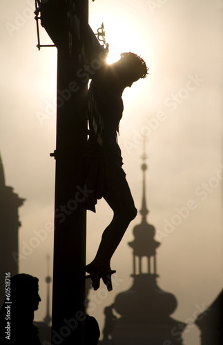 Fényképezés  Prague - cross on the charles bridge - silhouette