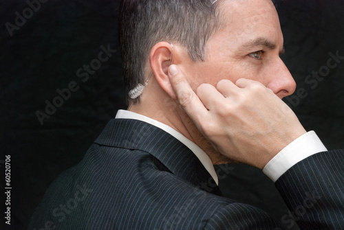 Photo  Secret Service Agent Listens To Earpiece, Side