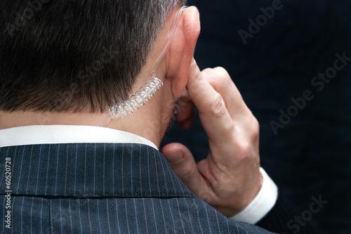Photo  Secret Service Agent Listens To Earpiece, Behind