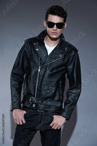 Macho retro rock and roll fifties fashion man with dark