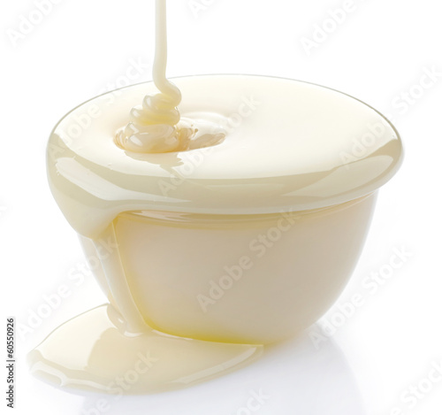 pouring condensed milk with sugar in a bowl