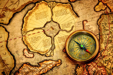 Vintage Compass Lies On An Anc...