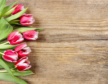 Bouquet Of Pink Tulips On Wooden Background. Copy Space
