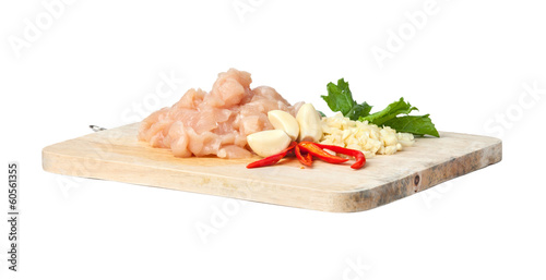 Fotografía  raw chicken meat on cutting board, isolated on white