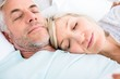 Loving mature couple sleeping in bed
