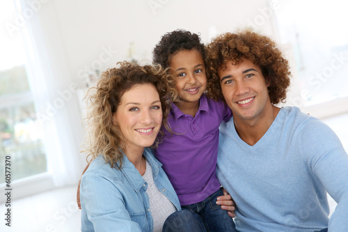 Happy family laying down the floor at home Canvas-taulu