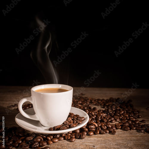 Foto op Canvas Cafe Cup of coffee and coffee beans on wooden background