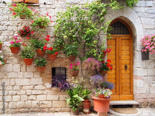 Fototapeta Colorful flowers outside a home in Assisi, Italy