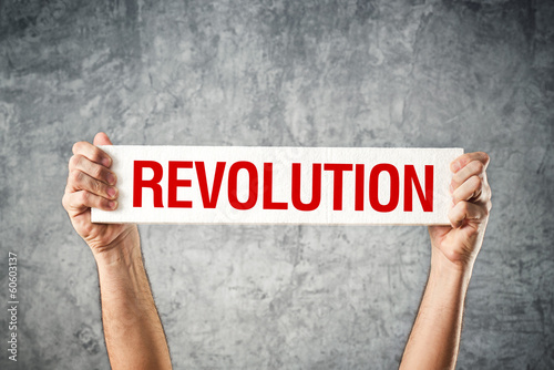 Man holding white banner with revolution title Canvas-taulu