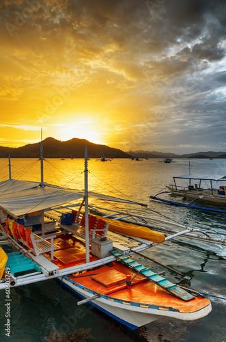 Foto op Plexiglas Venetie Traditional boats at sunset. Philippines