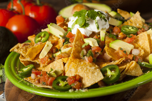 Fotografía  Homemade Unhealthy Nachos with Cheese and Vegetables